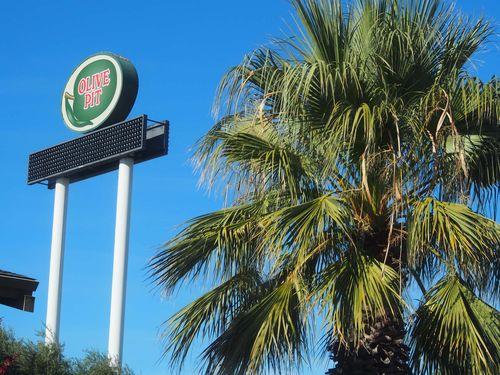 Olive pit sign